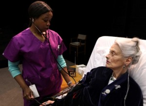 "Quincy Tyler Bernstine as Nurse Tina and Danielle Skraastad as Maxine in Lucas Hnath's ""Death Tax"" at 2012 Humana Festival of New American Plays"