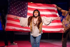 "Erick Perafan in ""HAIR"" at Mad Cow Theatre. Photo by Tom Hurst"