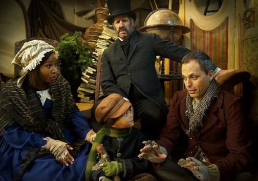 Orlando Shakespeare Theater's 'A Christmas Carol.' L to R: Danielle Renee, Steven Patterson (standing), Parker Sims-Chin, & Steven Lane. Photo by Landon St. Gordon