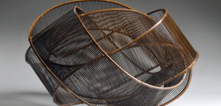 "Uematsu Chikuyu, ""Sound of Wind,"" 1991. Bamboo (madake), rattan, lacquer. Photo © Susan Einstein."