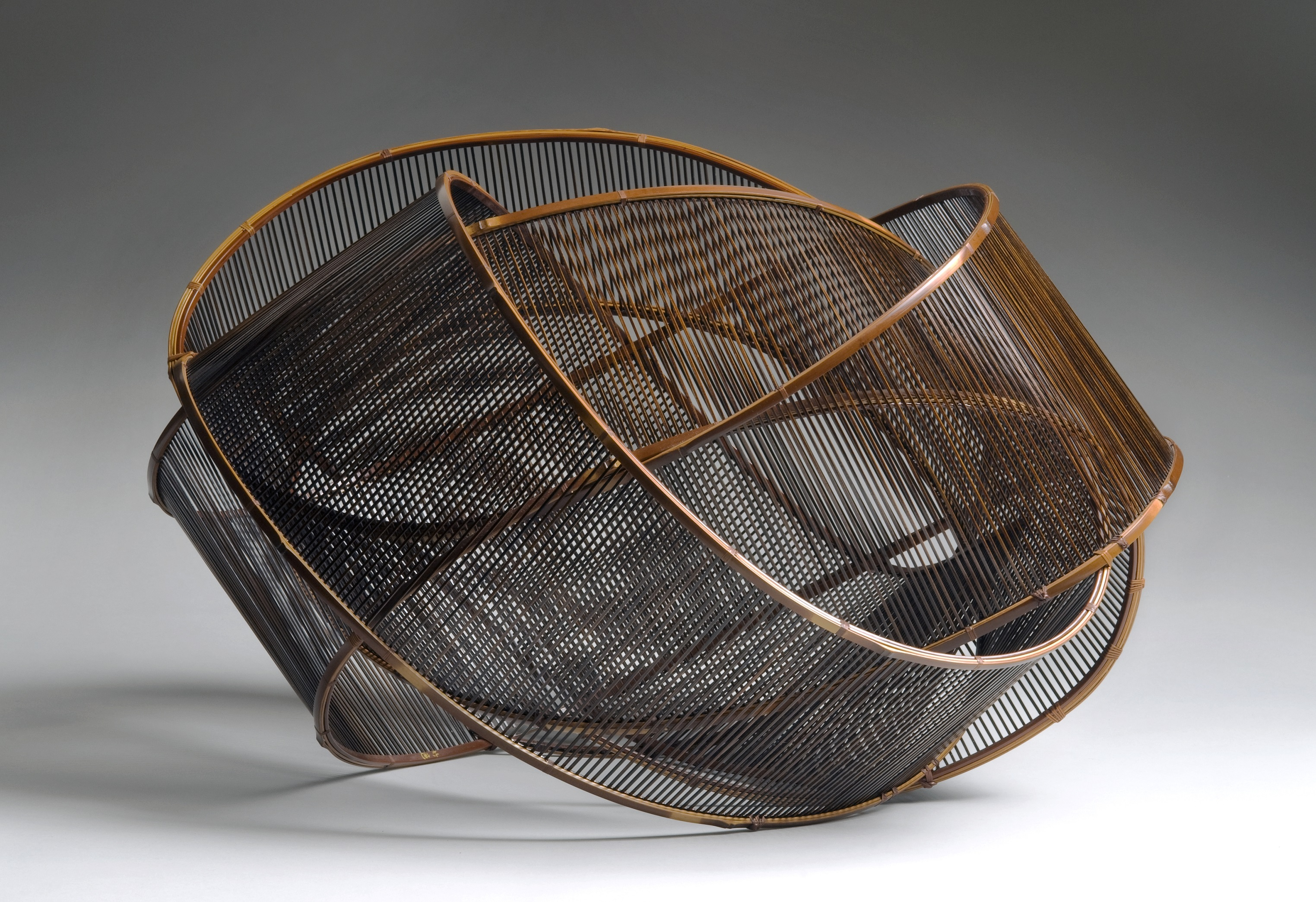 "Uematsu Chikuyu, ""Sound of Wind,"" 1991. Bamboo (madake), rattan, lacquer. Photo © Susan Einstein."