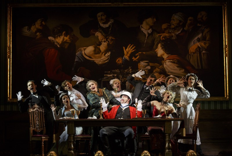 "National Touring Company. The cast with John Rapson as Lord Adalbert D'Ysquith (red ) in a scene from ""A Gentleman's Guide to Love & Murder.""Photo credit: Joan Marcus."