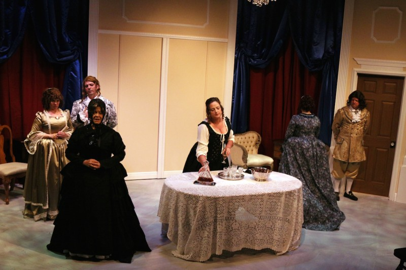 From left: Emily Pickens, Anthony DeTrano (in back), Nelia Lake, Tracey Thompson, Christina LaFortune (back turned) and Peter Olander in Melbourne Civic Theatre's 'Tartuffe.'