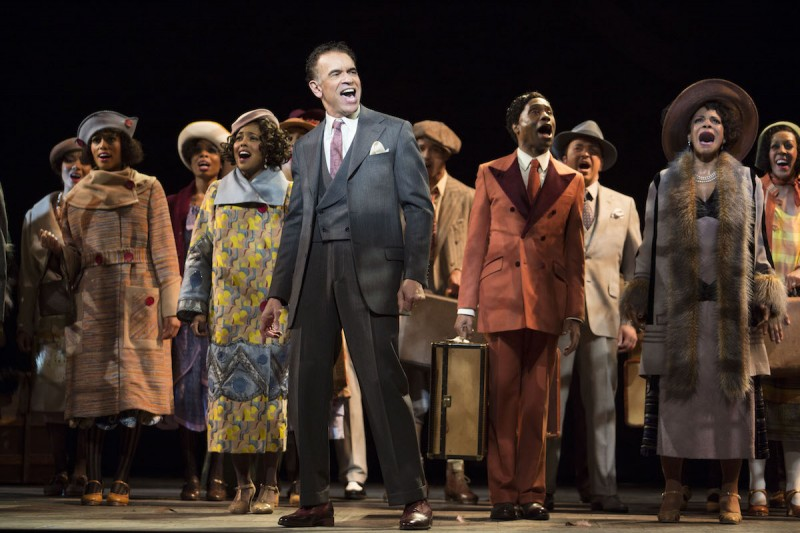Brian Stokes Mitchell, with Adrienne Warren (fourth from left), Billy Porter, Audra McDonald and ensemble in Shuffle Along, or The Making of the Musical Sensation of 1921 and All That Followed, featuring music and lyrics by Noble Sissle and Eubie Blake, book by F.E. Miller and Aubrey Lyles, with a new book and direction by George C. Wolfe and choreography by Savion Glover, at The Music Box Theatre (239 West 45th Street). © Julieta Cervantes