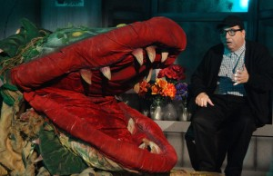 Audrey II and Steven Heron in Titusville Playhouse's LITTLE SHOP OF HORRORS. Photo by Doug Lebo
