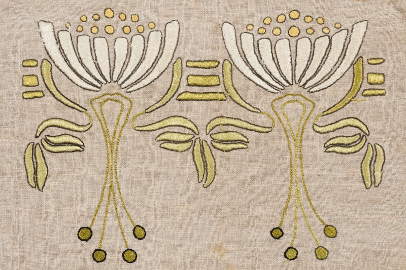 From FLORA & FIBER at the Ruth Funk Center for Textile Arts. Pillow cover (detail), United States, c. 1910. Linen, plain woven, chain stitch, satin-embroidered. Gift of Marilynn Johnson, 2006.02.01. Photo by Dominic Agostini